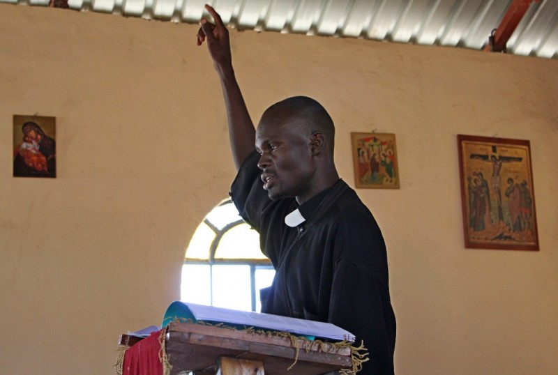 A sermon during the Liturgy in Kenya. Priest Vladimir