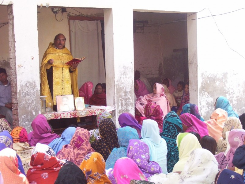 A sermon during the Liturgy in Pakistan. Priest Joseph Tanveer