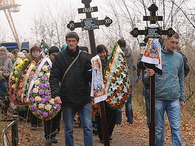 A funeral service performed over teenagers, killed during shelling of Donetsk