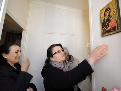 An Icon of the Mother of God is streaming myrrh in a Turkish family in Paris