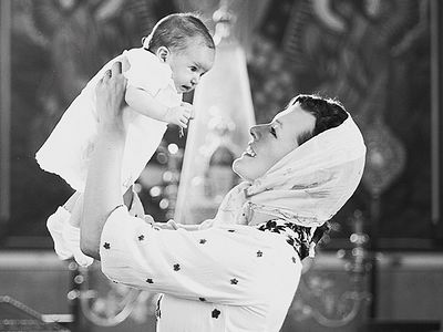 Milla Jovovich Shares Photos From Daughter's Russian Orthodox Baptism