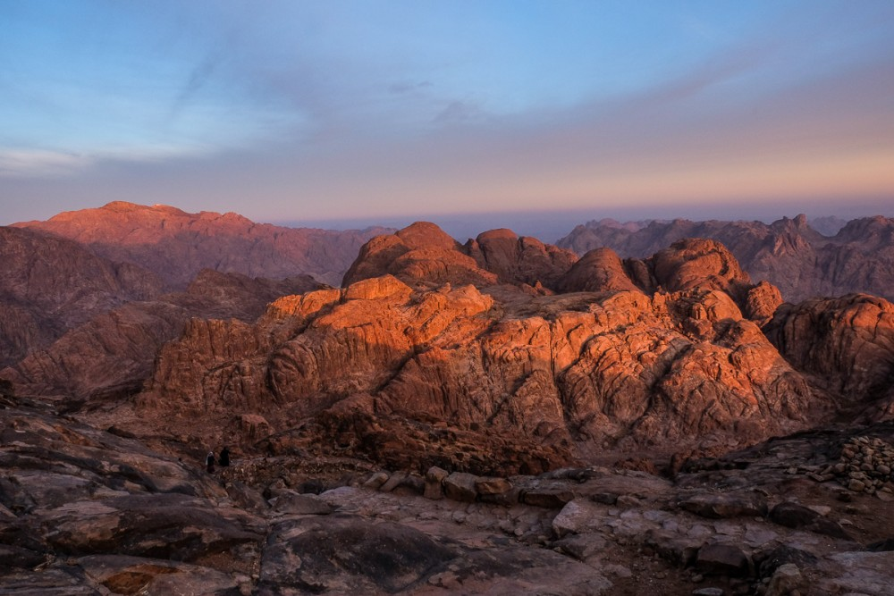 The first sunbeams are falling on the mountains of Sinai