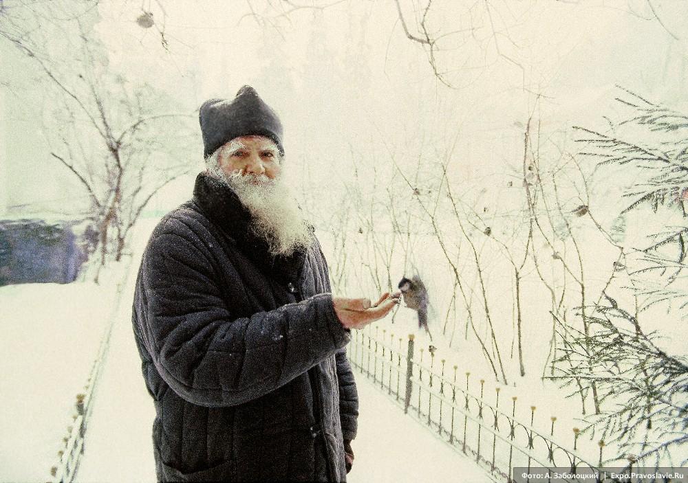 A monk fees a winter bird