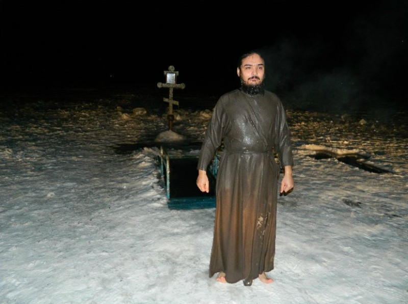 "Lake Balkhash, Kazakhstan: a priest right after immersing in an ice-hole (""prorub"")."