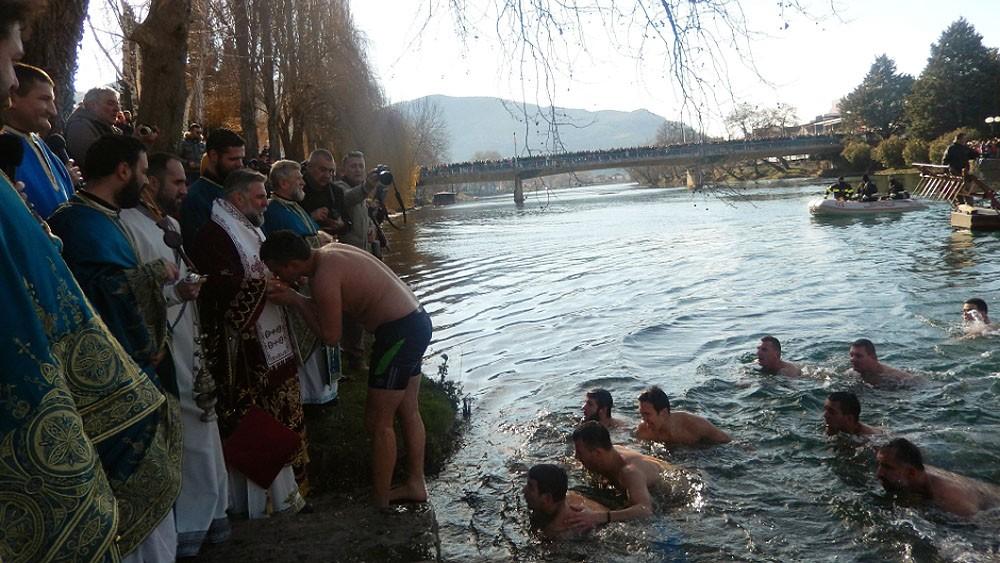 Trebinje. Participants in the swim recieve a blessing from Bishop Gregorije of Zahumlje and Herzegovina.