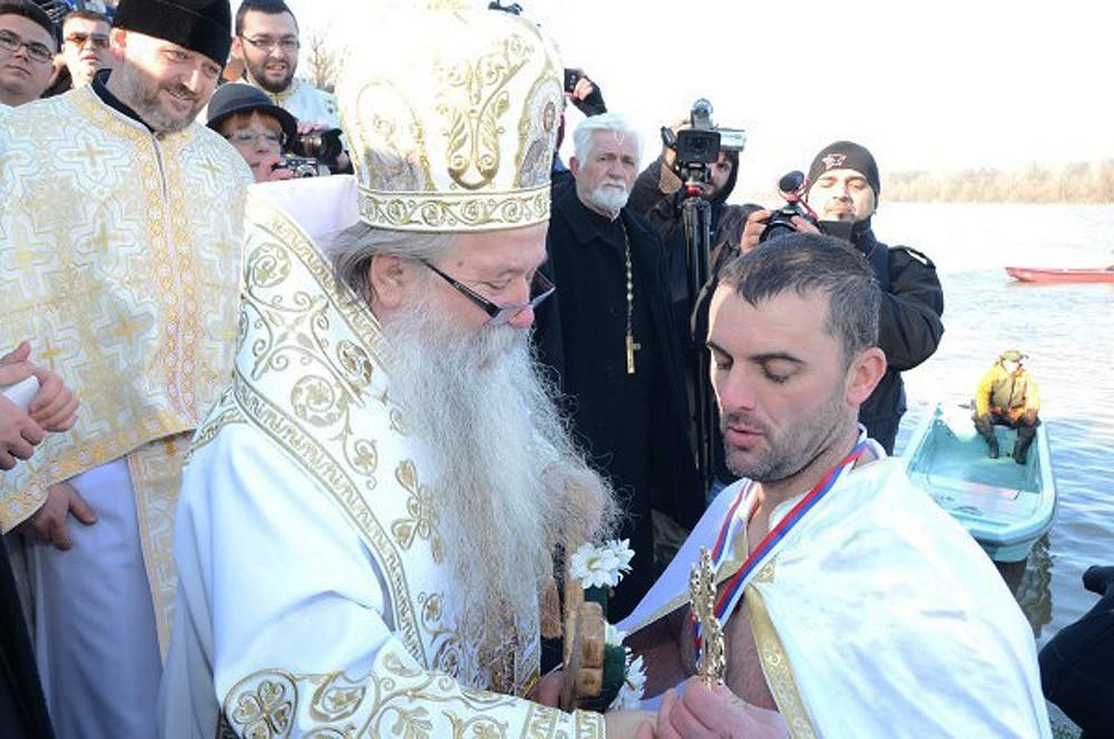 Brcko. Bishop Hryzostom of Zvornik and Tuzla awards the winner, Drasko Dzukic.