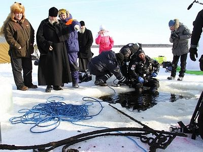 Yaroslavl Diocese exploring South Dorothea Hermitage under frozen reservoir